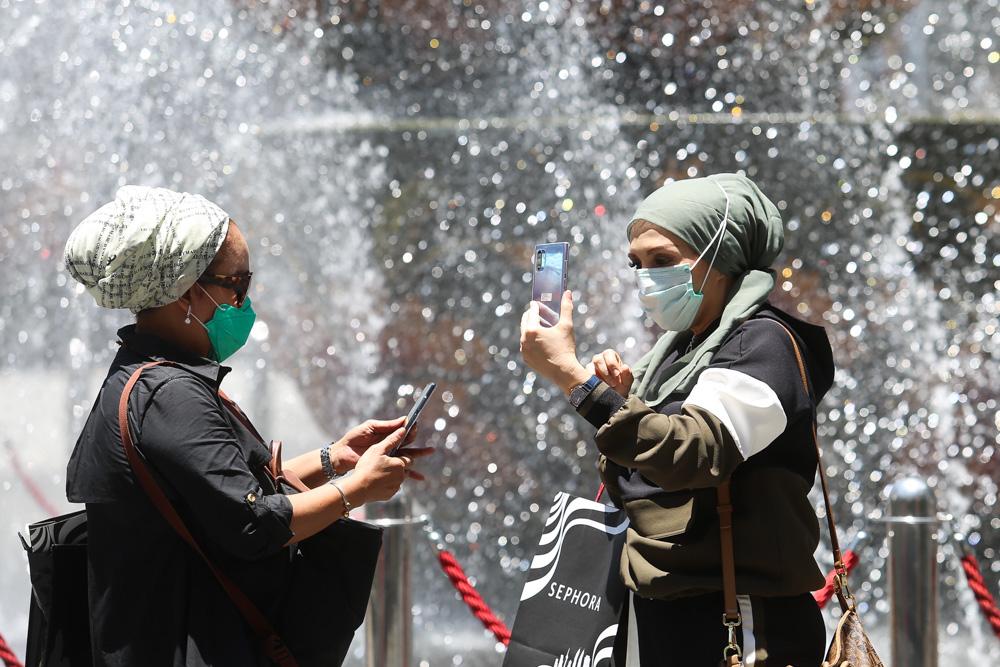 Tourists are seen wearing masks along Jalan Bukit Bintang, Kuala Lumpur March 16 2020. — Picture by Choo Choy May