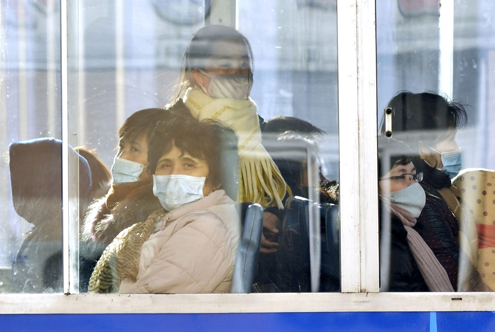 Passengers wear masks inside a trolley bus in Pyongyang, North Korea, in this photo taken February 22, 2020 and released by Kyodo February 23, 2020. — Picture by Kyodo via Reuters