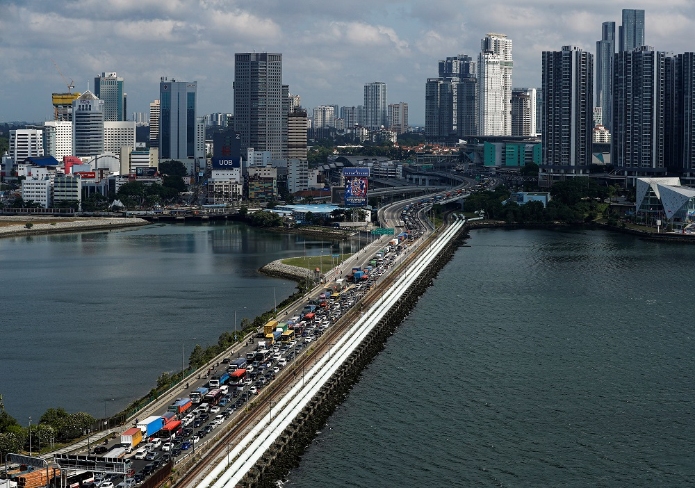 It was reported on September 11 that Malaysia's Health Ministry is looking at the possibility of fully reopening the Malaysia-Singapore border for daily commuters in January. — Reuters pic