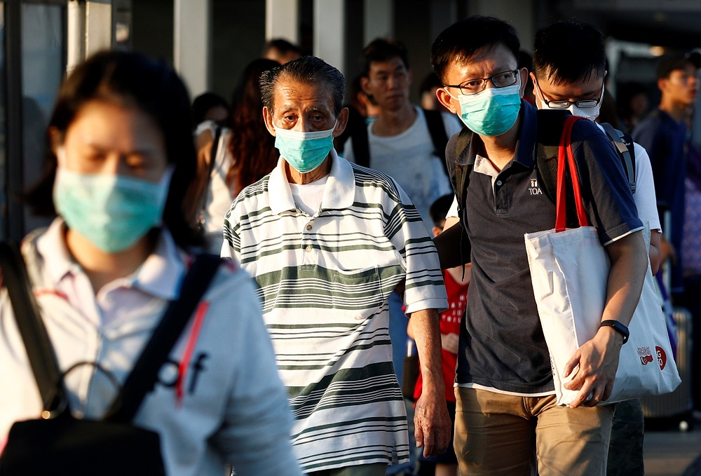 File picture shows commuters leaving the Woodlands Causeway across to Singapore from Johor, hours before Malaysia imposes a lockdown on travel due to the coronavirus outbreak, in Singapore March 17, 2020. — Reuters pic