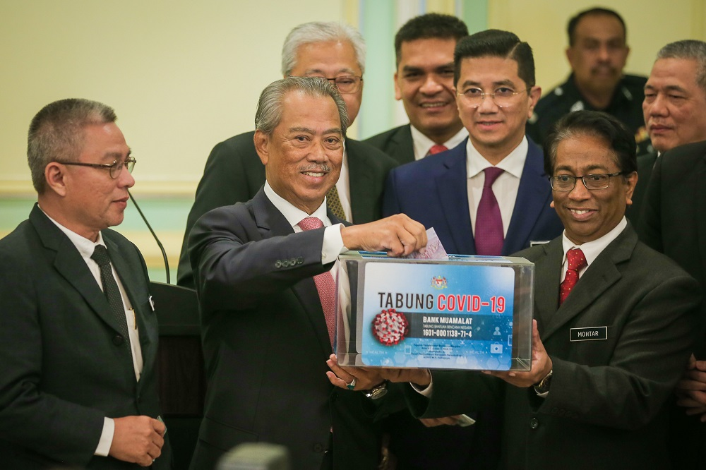 Prime Minister Tan Sri Muhyiddin Yassin launches the Covid-19 Fund at the Prime Minister Office's in Putrajaya March 11, 2020. — Picture by Yusof Mat Isa