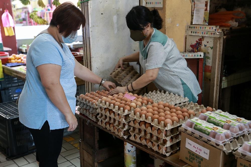 A woman is seen selling fresh eggs at a wet market in Petaling Jaya March 25,2020.  — Picture by Ahmad Zamzahuri