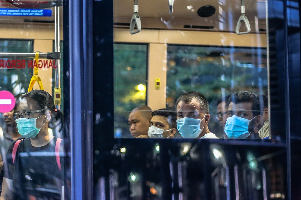 Bus passengers are seen wearing face masks amid the Covid-19 outbreak in Kuala Lumpur March 16, 2020. — Picture by Firdaus Latif