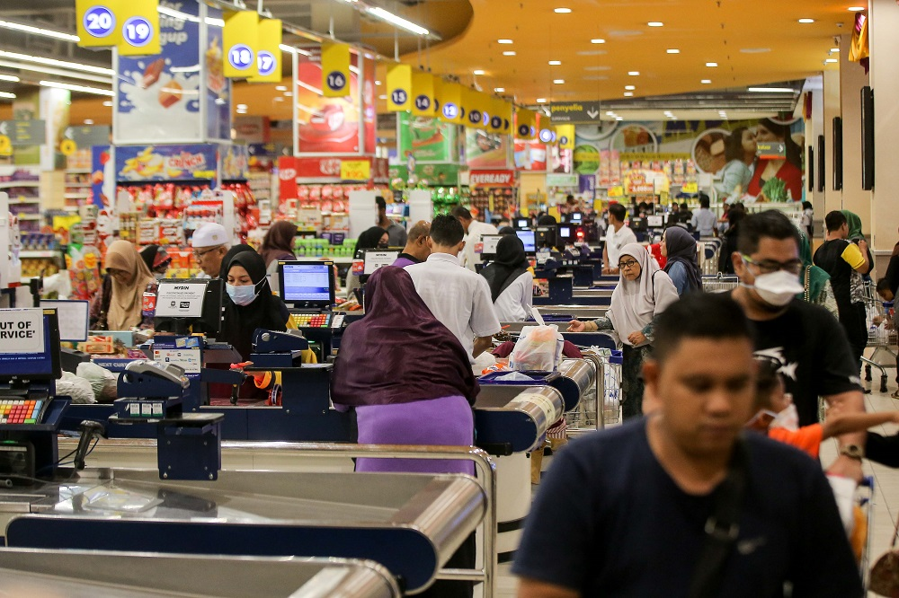 People are seen shopping for groceries and other essentials at Mydin Meru Raya in Ipoh March 16, 2020. — Picture by Farhan Najib