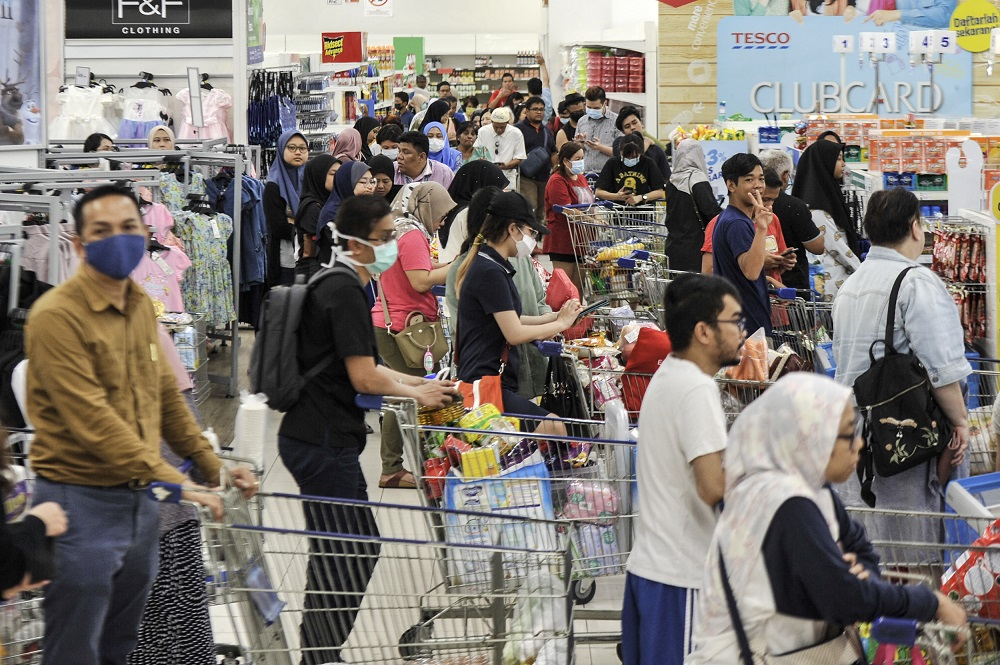 People are seen stocking up on food and other goods during the panic buying at a hypermarket in Kajang March 16, 2020. — Picture by Shafwan Zaidon