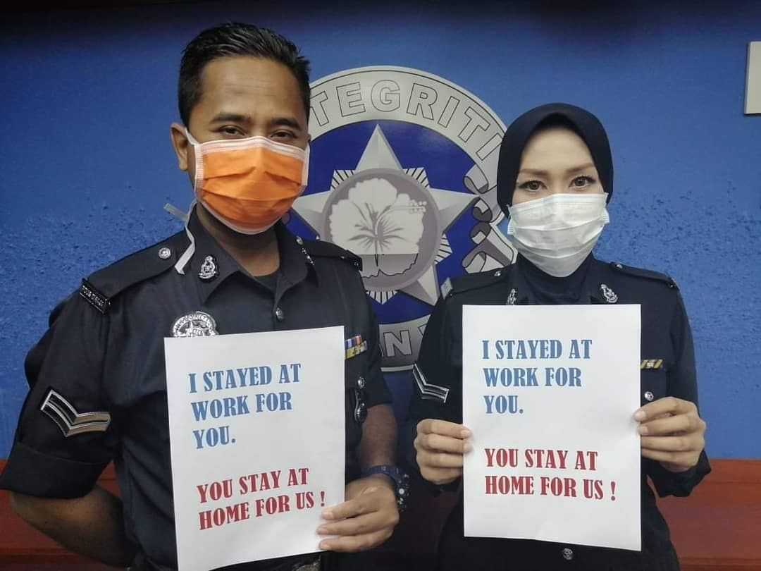 Royal Malaysia Police officers urge Malaysians to stay at home during the two-week nationwide movement control order. — Picture via Facebook/fopdrm