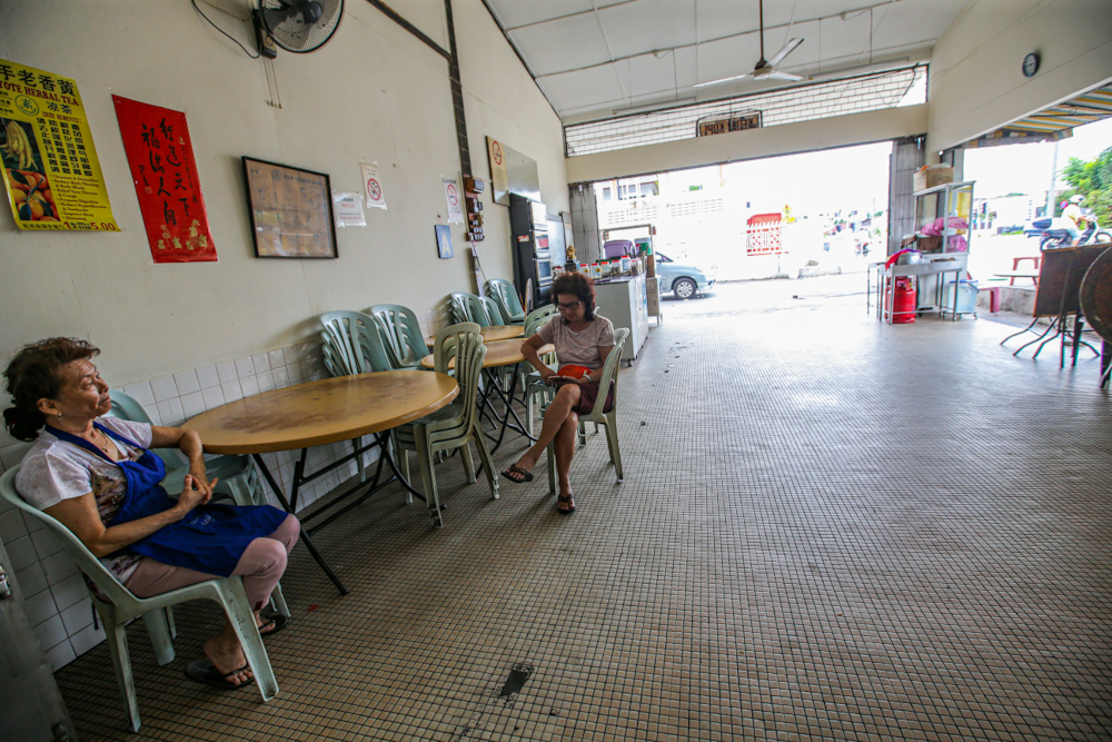 A general view of a coffeeshop in Kampung Ayer Panas, Kuala Lumpur March 21, 2020. 82 per cent of SMEs surveyed predicted a loss for the financial year 2020. — Picture by Hari Anggara
