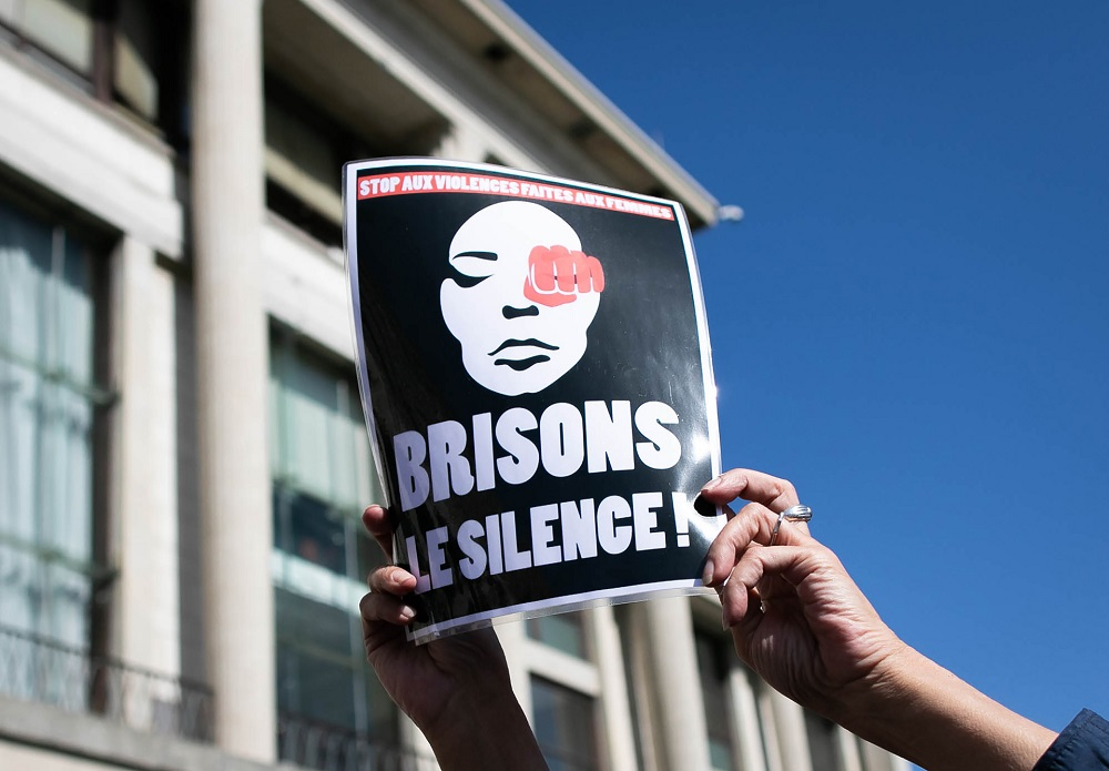 A person holds a sign reading 'Break the silence' during a rally to denounce femicides and domestic violence in Le Havre, northwestern France September 18, 2019. — AFP pic