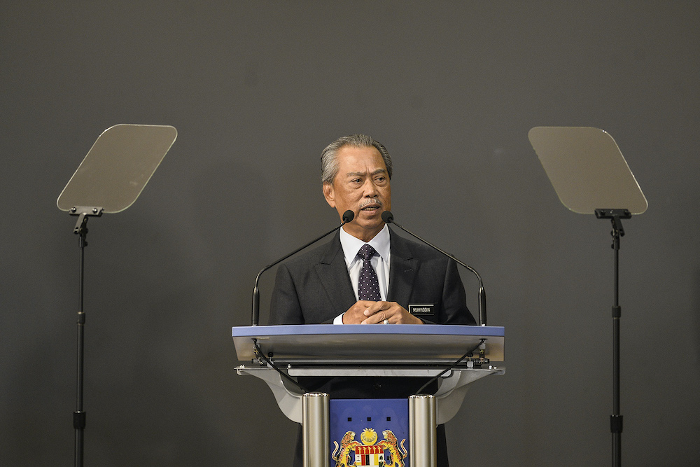 Prime Minister Tan Sri Muhyiddin Yassin speaks during a press conference in Putrajaya March 23, 2020. — Picture by Miera Zulyana