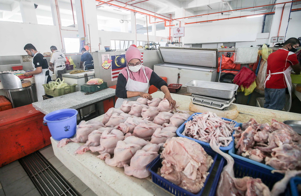 Chicken traders are pictured at the Ipoh Central Market March 25, 2020. Lily Rosalind said the frozen chicken from Thailand did not comply with the import requirements and is believed to have come from an unrecognised slaughterhouse. —  Picture by Farhan Najib