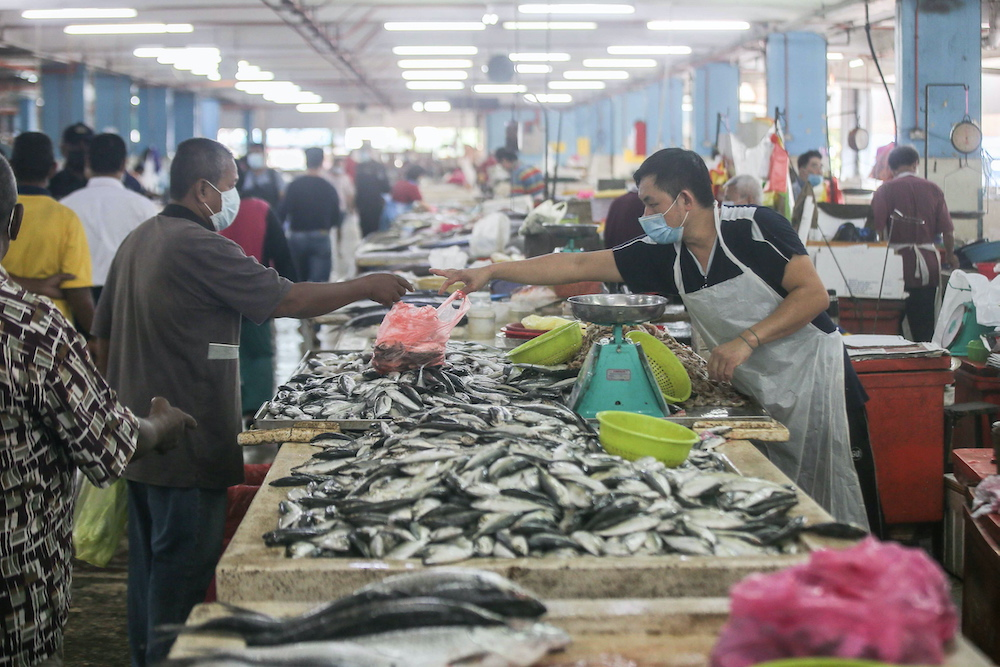 Traders say supply of fresh food such as seafood is adequate at the Ipoh Central Market despite the movement control order. —  Picture by Farhan Najib