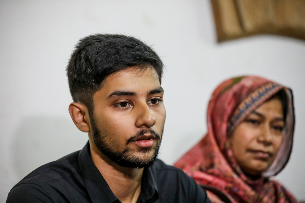 Monorom Palak, son of journalist Shafiqul Islam Kajol who recently disappeared, speaks to media representatives at the National Press club in Dhaka March 13, 2020. — AFP pic