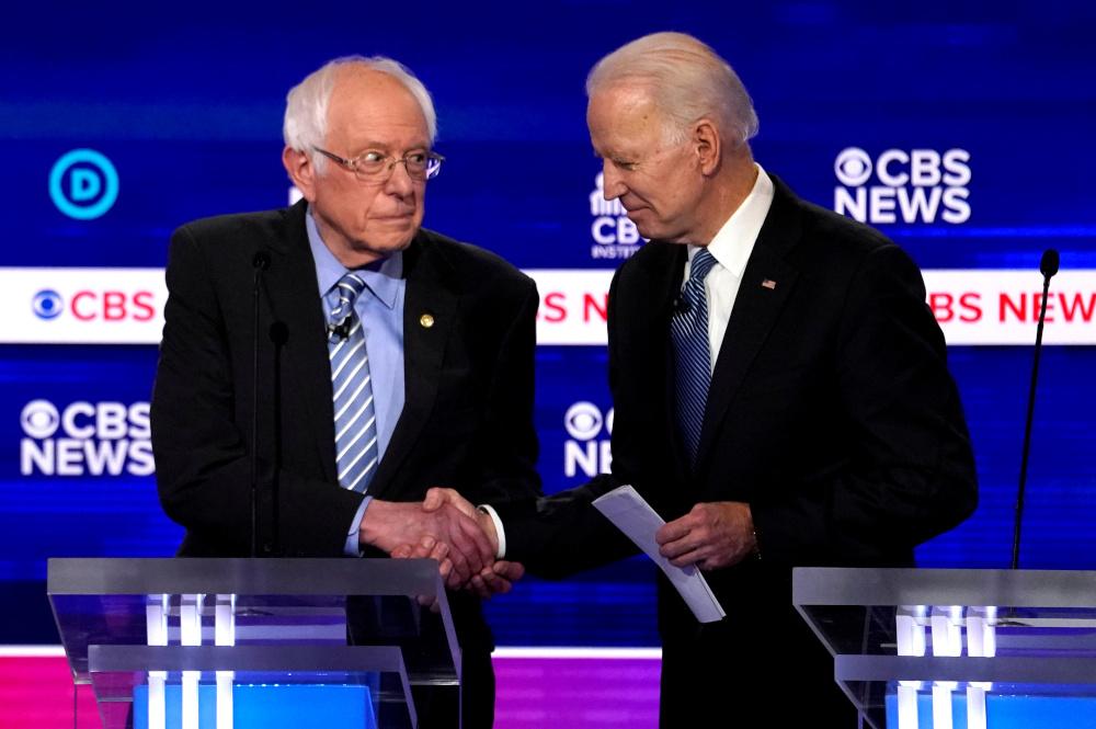 Democratic 2020 US presidential candidates Senator Bernie Sanders shakes hands with former Vice President Joe Biden after the 10th Democratic 2020 presidential debate in Charleston, South Carolina February 25, 2020. — Reuters pic