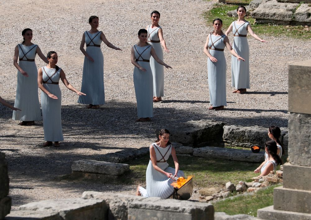 Greek actress Xanthi Georgiou, playing the role of High Priestess lights the flame during the dress rehearsal for the Olympic flame lighting ceremony for the Tokyo 2020 Summer Olympics, at Olympia, Greece - March 11, 2020. — Reuters pic