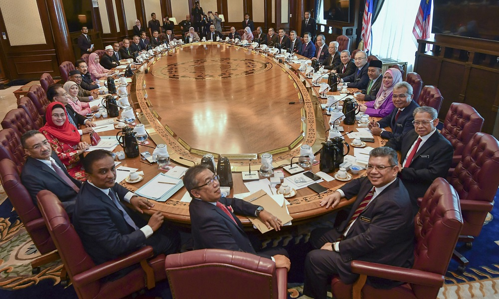 Prime Minister Tan Sri Muhyiddin Yassin poses with Cabinet ministers before the first new Cabinet meeting at Perdana Putra in Putrajaya March 11, 2020. — Bernama pic