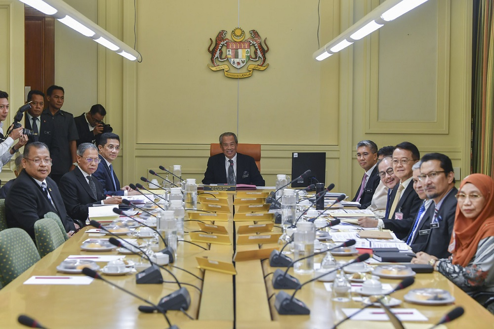 Prime Minister Tan Sri Muhyiddin Yassin (centre) chairs the Economic Action Council meeting at Putrajaya March 16, 2020. — Bernama pic
