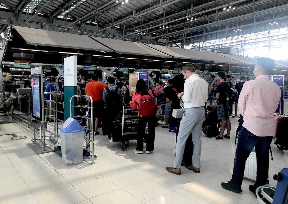 People wait in queues at the Suvarnabhumi Airport in Bangkok March 17, 2020. — Bernama pic