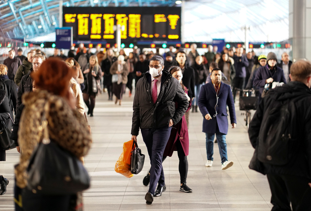 A man is seen wearing a protective face mask at Waterloo station in London, Britain, March 6, 2020. — Reuters pic