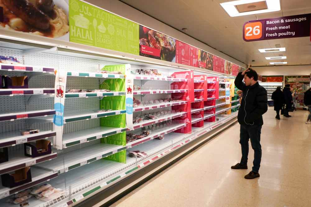 A man stands next to shelves empty of fresh meat in a supermarket, as the number of worldwide coronavirus cases continues to grow, in London March 15, 2020. ― Reuters pic