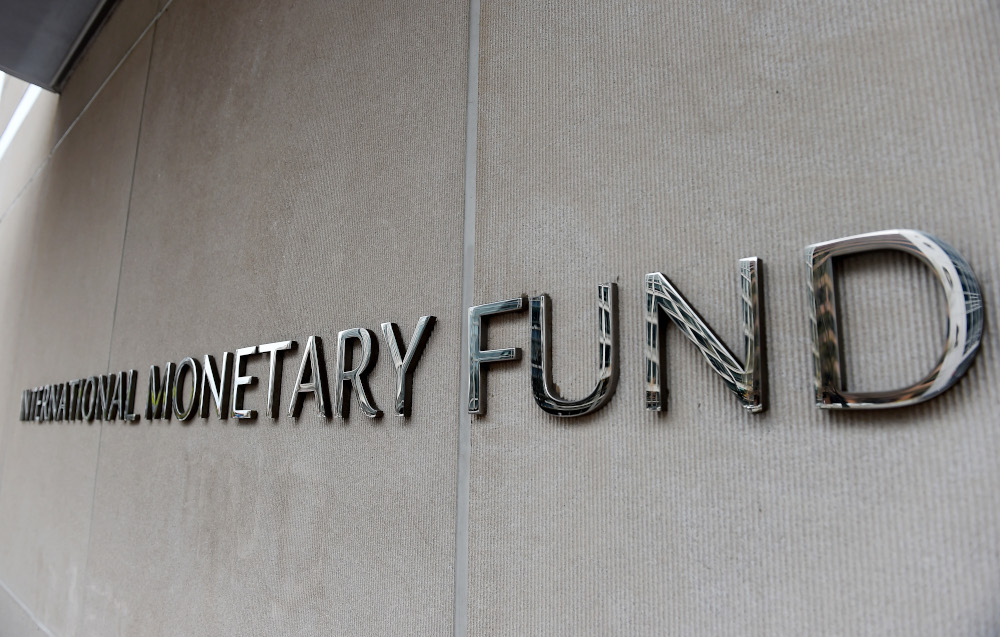An exterior view of the building of the International Monetary Fund (IMF), with the IMG logo, is seen on March 27, 2020 in Washington, DC. — AFP pic