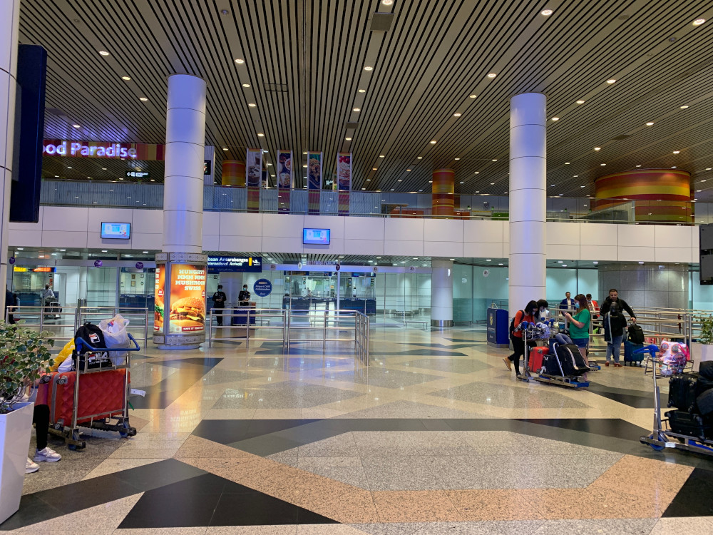 Ghost airport: Very few Malaysian passengers seen waiting around at the arrival area. — Picture by Thasha Jayamanogaran