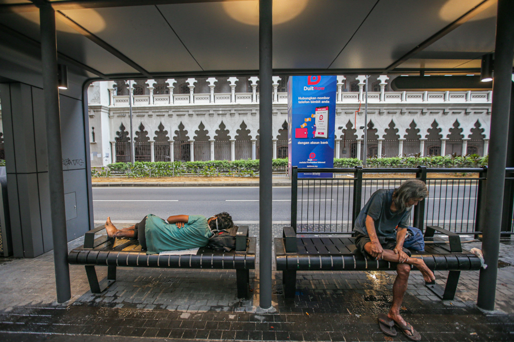 The homeless can still be seen everywhere around the Kuala Lumpur city centre March 21, 2020, on the fourth day of the movement control order enforced to control the spread of Covid-19. — Picture by Hari Anggara