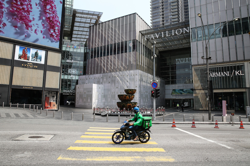 File photo of a food delivery rider riding past Pavilion in Kuala Lumpur March 21, 2020. — Picture by Yusof Mat Isa