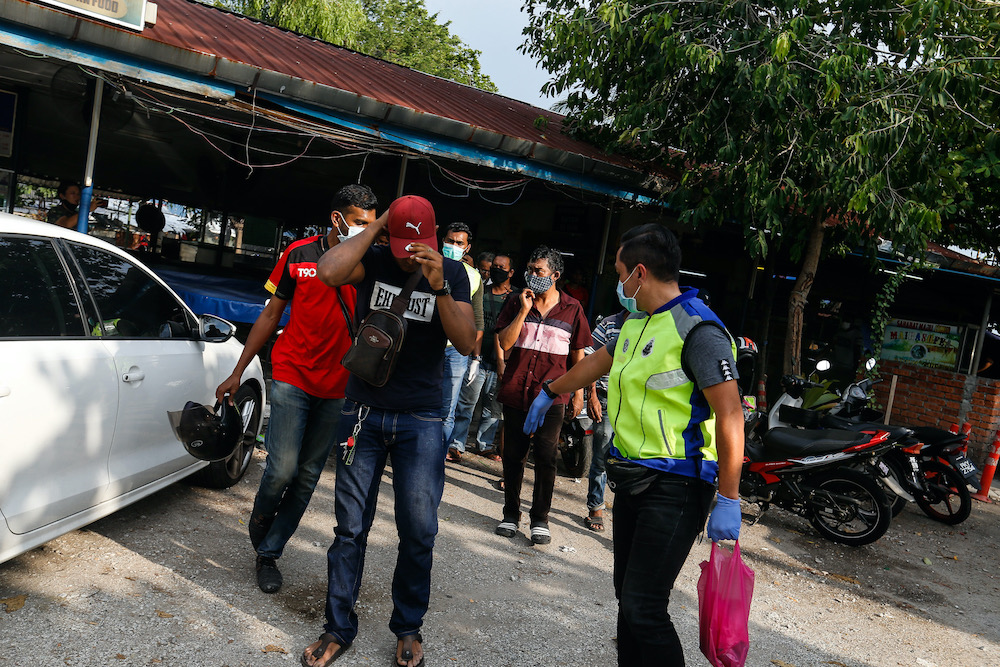 Police arrest youths who violate the movement control order in Jelutong, Penang, March 28, 2020. — Picture by Sayuti Zainudi