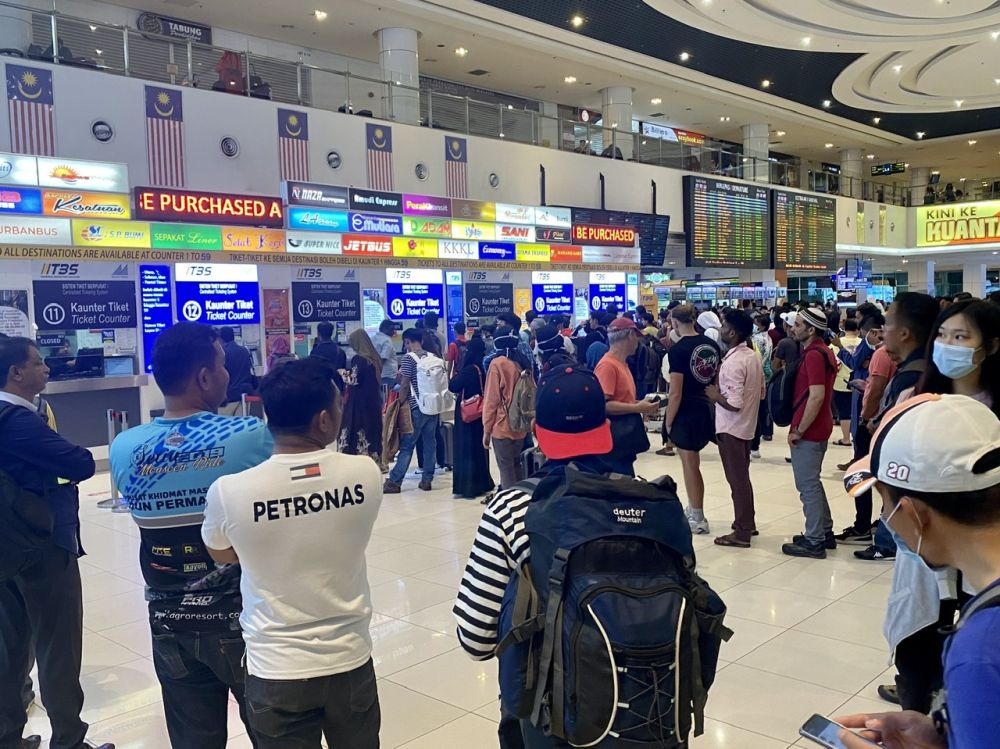 The large crowd at the Terminal Bersepadu Selatan (TBS) last night following the government's abrupt decision to implement a nationwide shutdown starting today. — Picture by Ben Tan