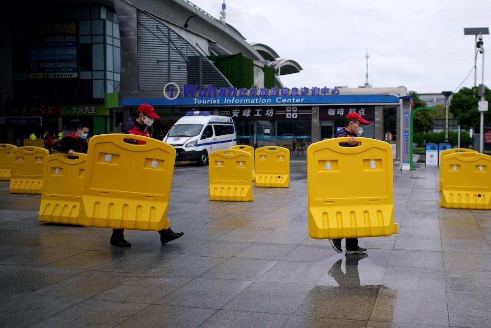 Staff members move barriers in front of a railway station of Wuhan on the first day of inbound train services resumed following the novel coronavirus disease (Covid-19) outbreak, in Wuhan of Hubei province, the epicentre of China's coronavirus outbreak,