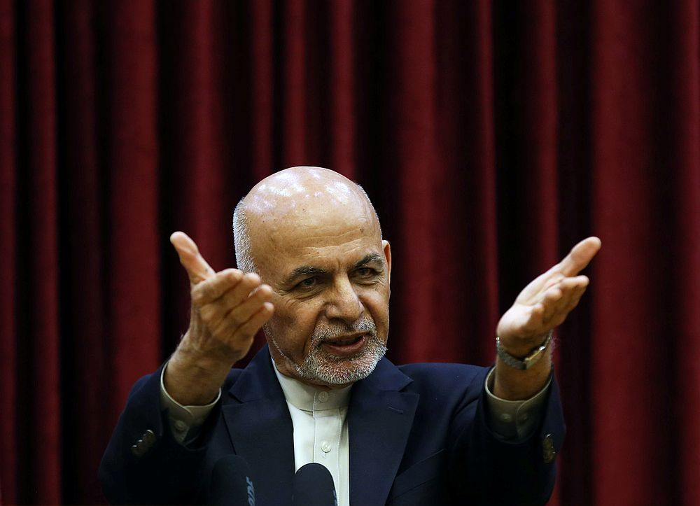 Afghanistan's President Ashraf Ghani warned yesterday that the release of Taliban prisoners was a 'danger' to the world. — Reuters pic