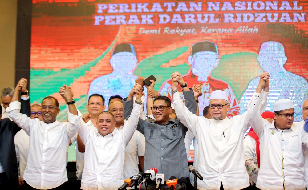 Perak Mentri Besar Datuk Seri Ahmad Faizal Azumu (centre) poses for a group picture with Perak Umno and PAS leaders after a press conference in Ipoh March 9, 2020. — Picture by Farhan Najib