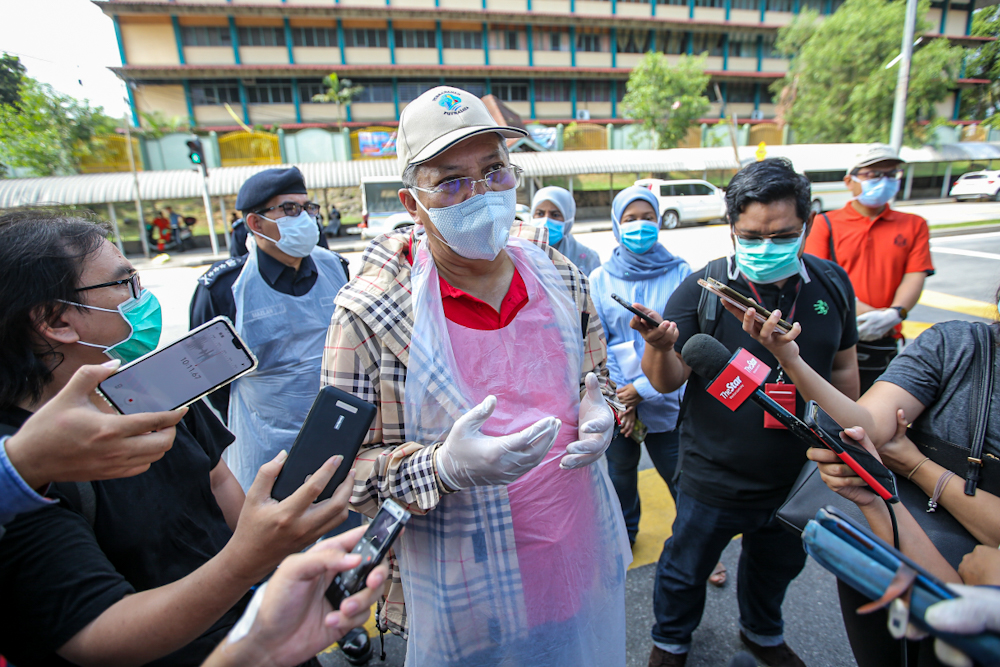 Federal Territories Minister Tan Sri Annuar Musa speaks to reporters after inspecting the sanitisation operations at the area around the Sri Petaling Mosque on March 28, 2020. ― Pictures by Hari Anggara