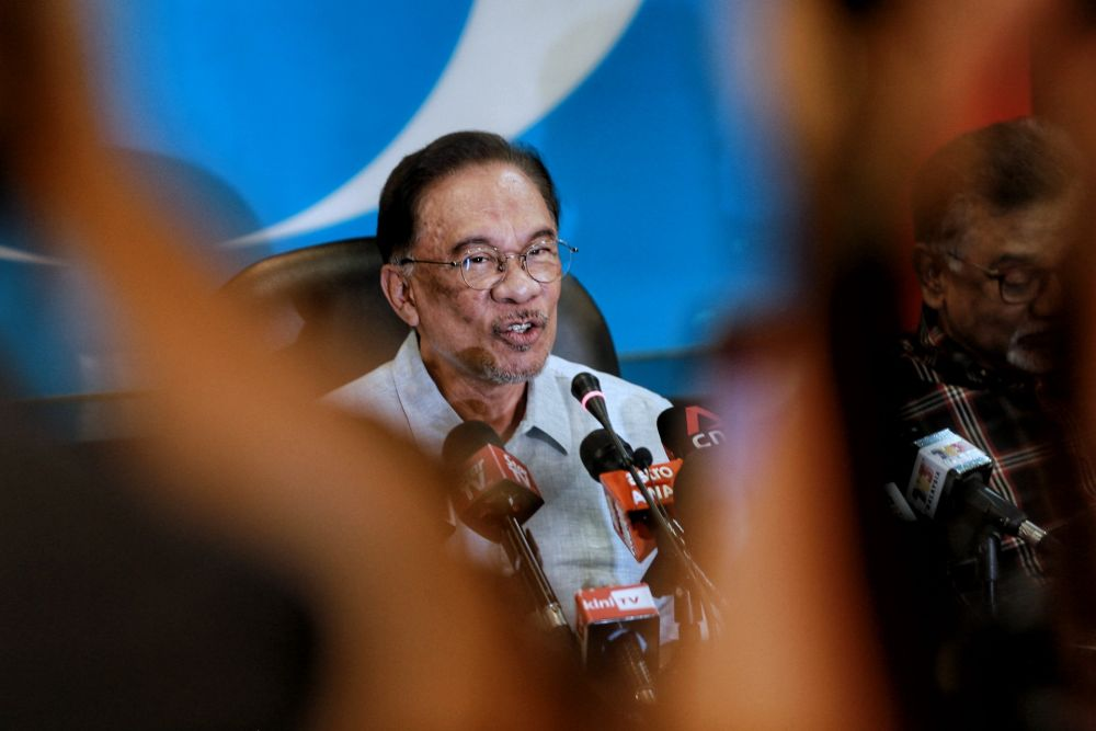 PKR president Datuk Seri Anwar Ibrahim speaks to reporters during a press conference at the party's headquarters in Petaling Jaya March 13, 2020. — Picture by Ahmad Zamzahuri