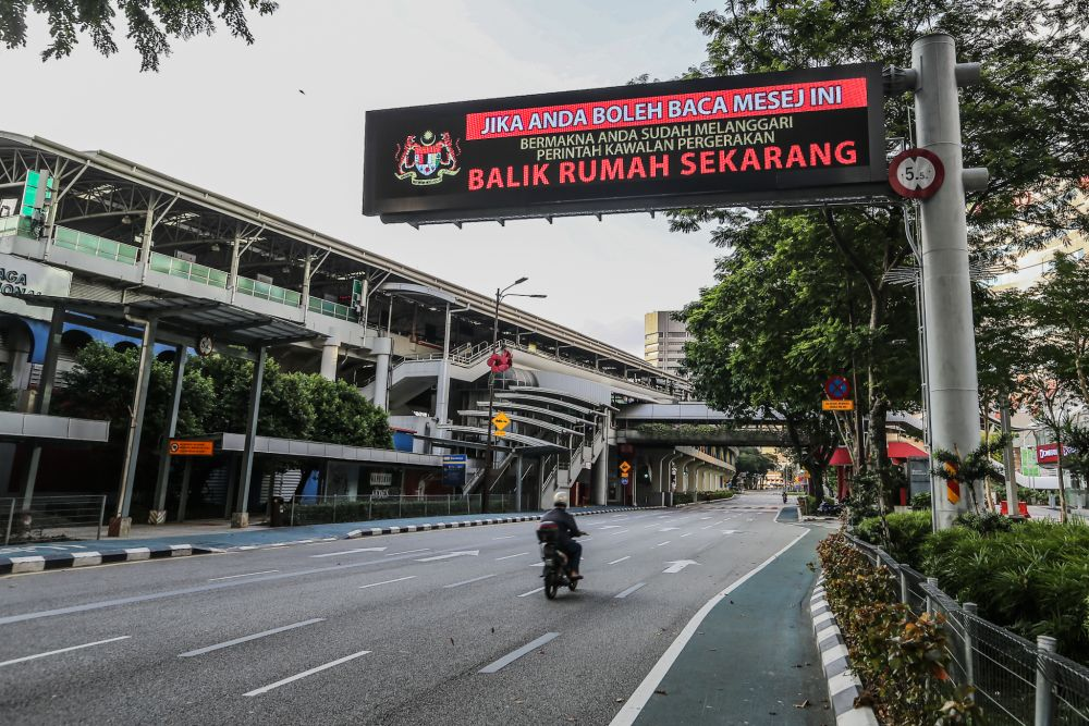 A billboard displaying a message on the movement control order is pictured in Kuala Lumpur March 31, 2020. — Picture by Firdaus Latif