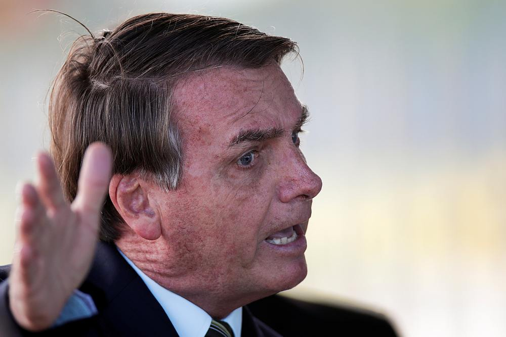 President Jair Bolsonaro lashed out yesterday at the 'cowardice' of Brazil's most widely viewed TV network for suggesting he bore heavy blame for the nation's more than 100,000 coronavirus deaths. — Reuters pic