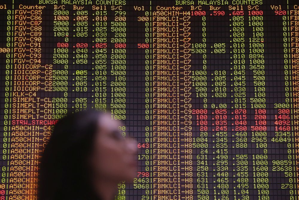 An investor monitors the stock prices in the gallery of the RHB Investment Bank Bhd headquarters in Kuala Lumpur March 17, 2020. ― Picture by Hari Anggara