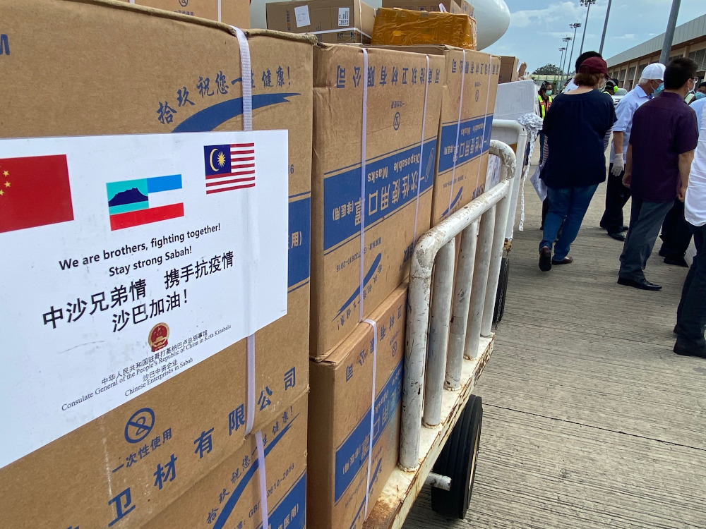 Boxes of masks and other medical gear arrived from China to Sabah. — Picture by Julia Chan