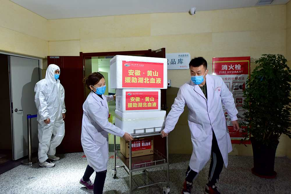 Staff members wearing face masks move blood supplies to be sent to Wuhan at a blood centre in Hefei, Anhui province, China March 1, 2020. — China Daily pic via Reuters