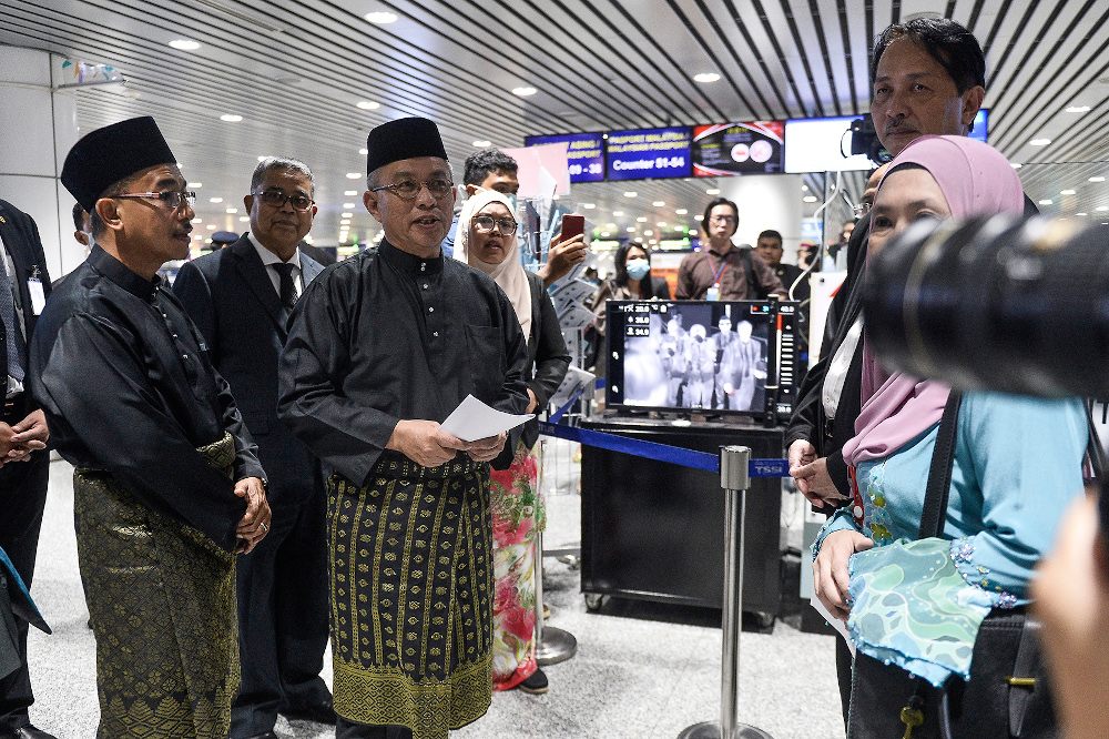 Health Minister Datuk Seri Dr Adham Baba speaks during a walkabout at KLIA March 10,2020. — Picture by Miera Zulyana
