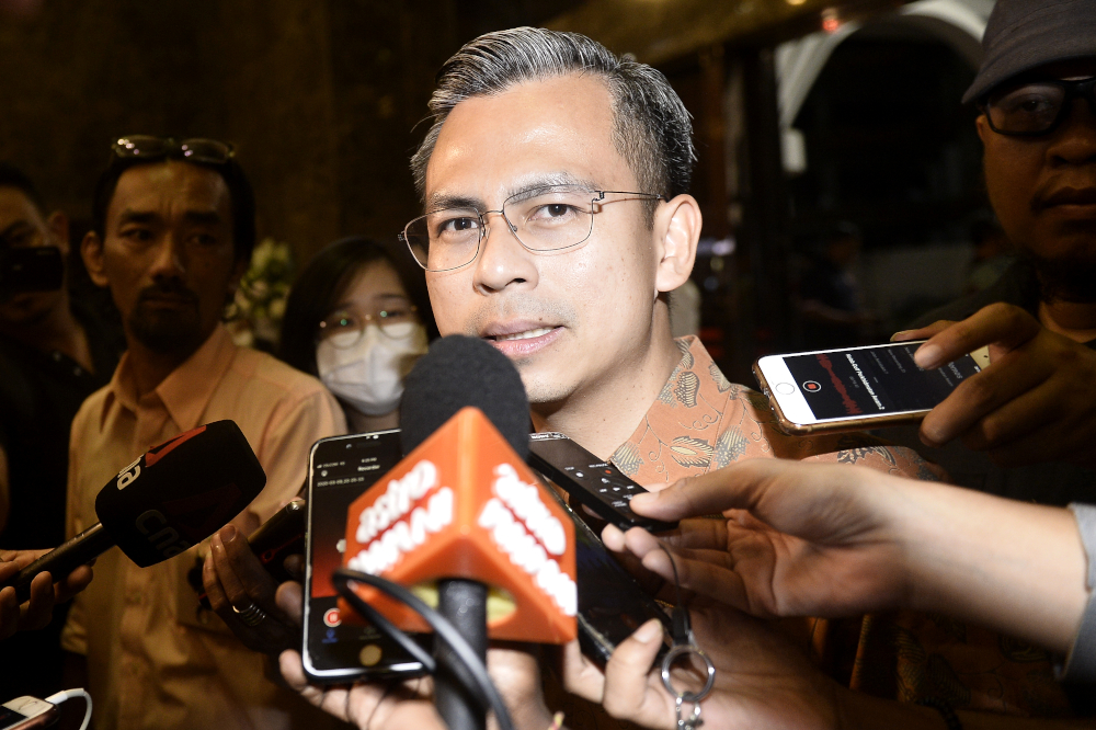 Fahmi Fadzil today questioned the basis of the Department of Information's advisory circular that classified insults towards the ruling government and its leaders as possible fake news. — Picture by Miera Zulyana