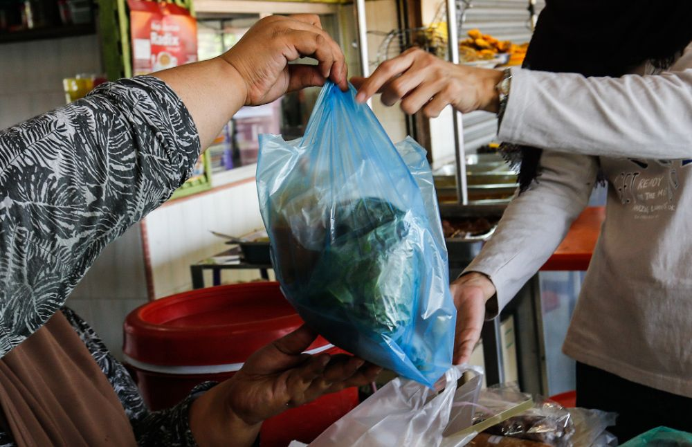 The use of plastic packaging has predictably surged, especially in the food delivery category as merchants seek to keep costs down while ensuring food safety. — Picture by Sayuti Zainudin