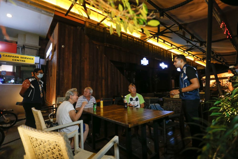 Penang Island City Council enforcement officers conduct spotchecks on pubs and eateries in George Town March 19, 2020. — Picture by Sayuti Zainudin