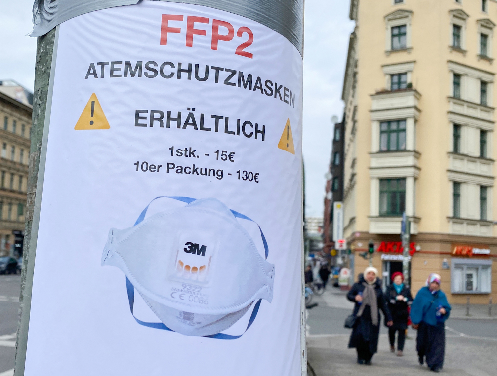 A sign advertising the sale of FFP2 protective face masks is taped to a lamppost in Berlin March 4, 2020. — AFP pic