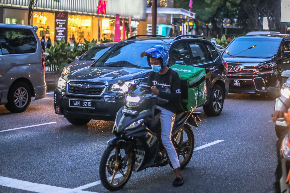 A GrabFood rider is pictured amid the Covid-19 outbreak in Kuala Lumpur 16, 2020. — Picture by Firdaus Latif