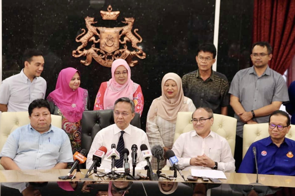 Newly-minted Johor Mentri Besar Datuk Hasni Mohammad (centre) hopes that the new exco line-up will take their oath of office this Friday. — Picture by Ben Tan