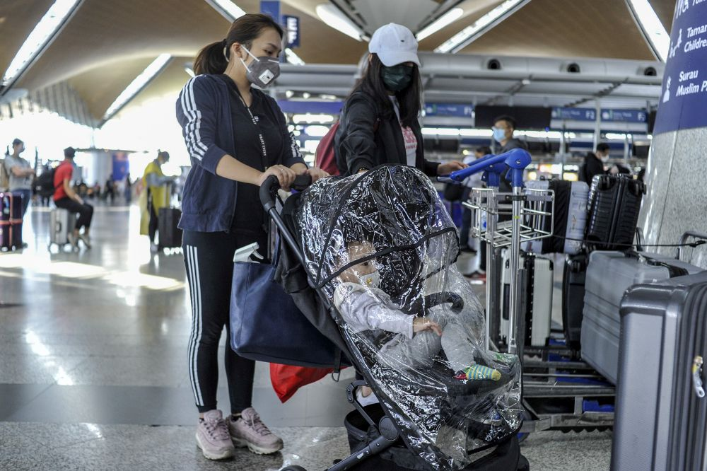 Travellers are pictured at the Kuala Lumpur International Airport in Sepang March 17, 2020. — Picture by Shafwan Zaidon
