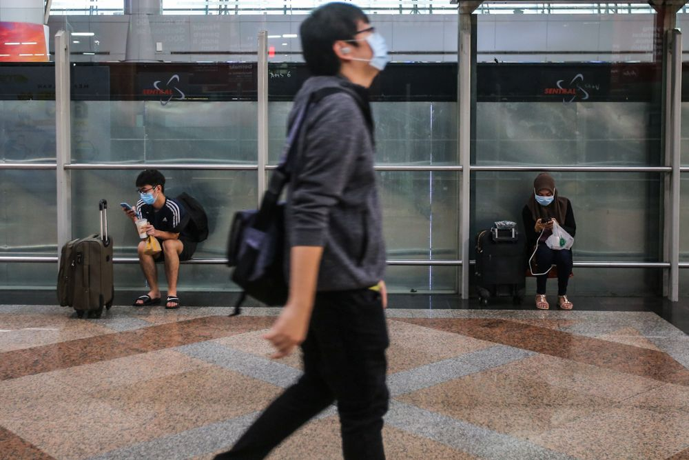 Commuters wearing face masks are pictured at the KL Sentral public transportation hub in Kuala Lumpur March 18, 2020. — Picture by Hari Anggara