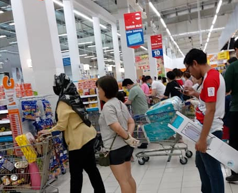 People queue at Tesco in Cheras with their groceries amid fear of a lockdown by the Malaysian government following a spike in Covid-19 cases, in Kuala Lumpur March 16, 2020. — Picture courtesy of R. Mages