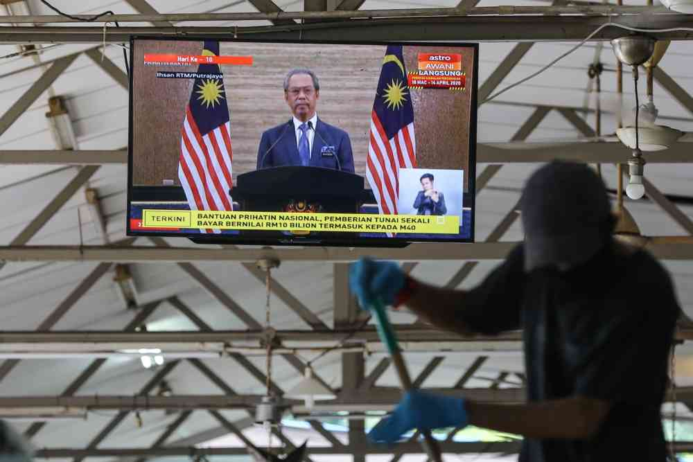 A live broadcast of Prime Minister Tan Sri Muhyiddin Yassin unveiling the RM250 billion stimulus package in Kuala Lumpur March 27, 2020. ― Picture by Yusof Mat Isa